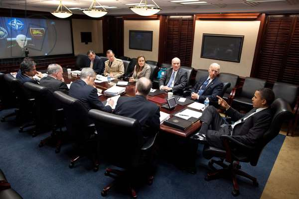 President Obama and VP Joe Biden hold a teleconference on Libya with Admiral Samuel Locklear Commander U.S. Naval Forces Europe on screen . White House Situation Room. Attendees include Leo Panetta CIA Director Gen. Mike Mullen Bill Daley Joe Biden (BSWH_2011_8_135)