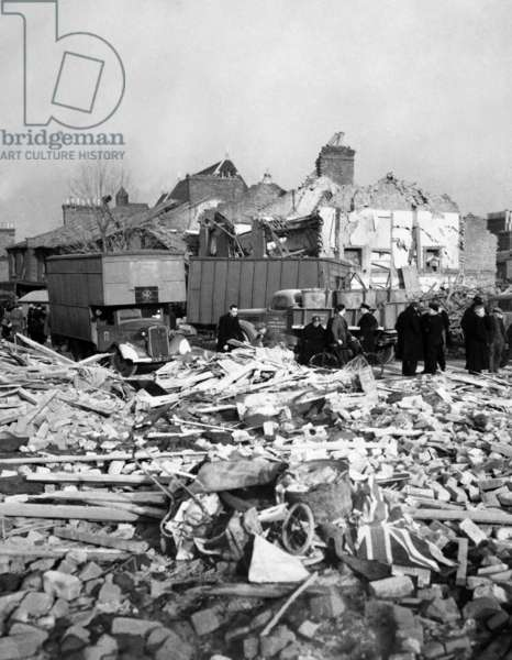 World War 2, Battle of Britain. A Union Jack flag lies among the rubble of homes smashed by a German missile, either a V-1 or V-2. Camberwell Road, London, 1944-45