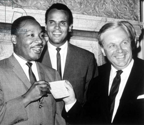 Martin Luther King, Jr., accepting a ,000 check from Tore Tellroth, the Swedish Consul General. Harry Belafonte is center. The money was raised in Sweden for Dr. King's civil rights work, 1966