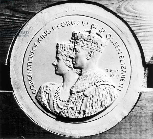 A medal being struck at the Royal mont to commemmorate the coronation of King George VI, and his wife Queen Elizabeth, England, December 23, 1936