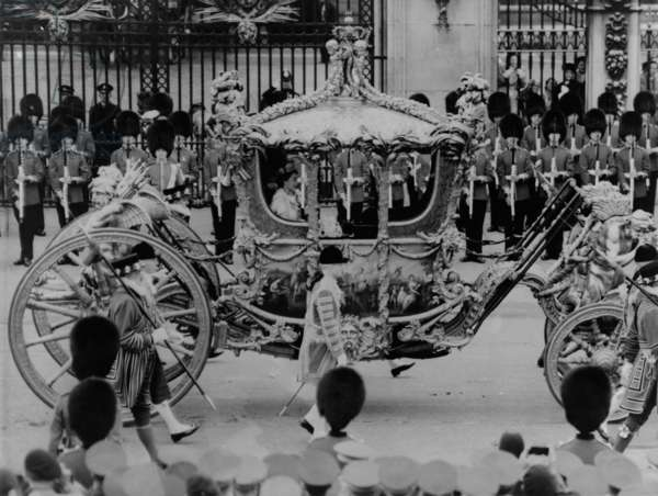 Queen Elizabeth II riding in the Gold State Coach enroute to her coronation. June 6, 1953.