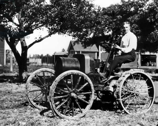 Henry Ford at the controls of one of his first tractors powered by a 1904 Model-B type engine. Near Dearborn, Michigan, 1908