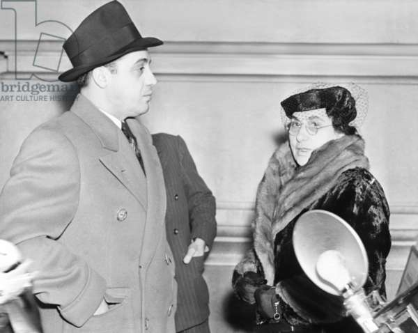 Al Capone's mother Teresa, and brother Ralph photographed in Federal Prison at Terminal Island. Los Angeles. They were there to visit Al Capone on Feb. 27, 1939. -