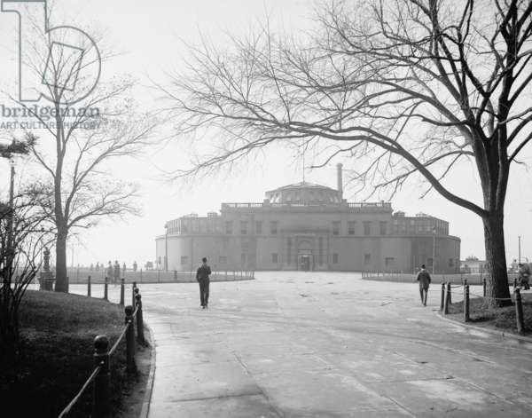 Castle Garden at New York City's Battery was built in New York Harbor to defend against a British invasion during the Napoleonic wars in 1807. When Ellis island took over immigrant reception in 1905, it was converted into an aquarium. c. 1901