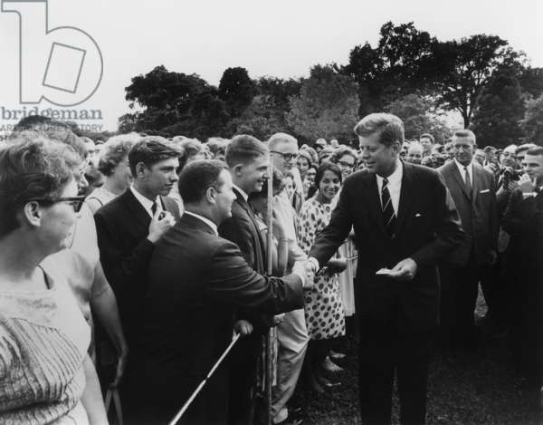 President John Kennedy meets with one of the first groups of Peace Corps volunteers. White House lawn, Aug. 11, 1961