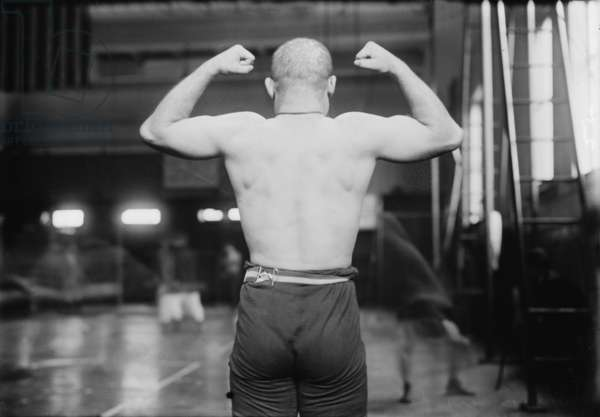 Strong man flexing muscles, Yussif Mahmout, photograph, c.1900s-1920s