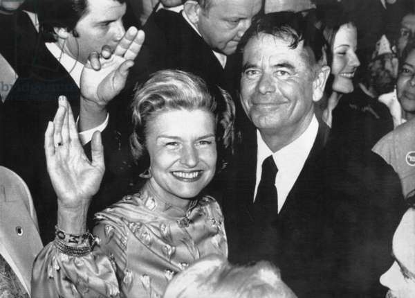 First Lady Betty Ford and actor Glenn Ford wave to the crowd at a 'Women Involved' rally during Mrs. Ford's three day campaign swing through Southern California, Los Angeles, March 10, 1976