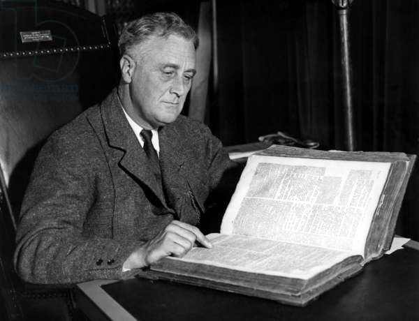 President Franklin Delano Roosevelt (1882-1945) 32nd President, with 263 year old family bible to be used for his oath of office, 2/27/33
