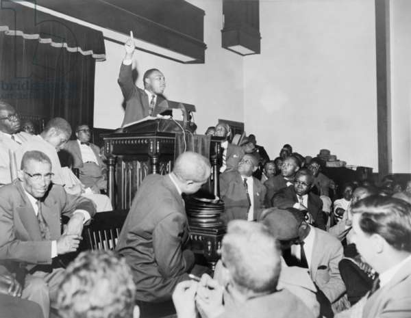 Rev. Martin Luther King, Jr., speaking at a meeting of the Montgomery Improvement Association, the organization form after Rosa Parks was arrested for not moving to the back of the bus. Earlier, King, then, only 27 years old, was elected the organization's leader. 1956