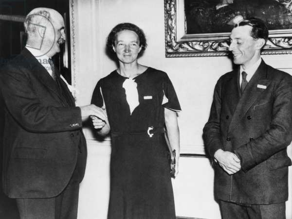 Irene Joliot-Curie with Sir William Brace, head of the Royal Institution, and Frederic Joliot. Oct. 10, 1934. Mme. Joliot-Curie will address the International Conference on Physics with her husband Frederic Joliot-Curie