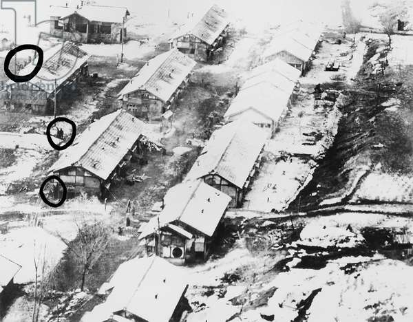 Aerial photo taken by a low flying U.S. Air Force jet of Chiktong POW camp in North Korea. In the circles are men, some waving. c. 1950-51. Korean War, 1950-53