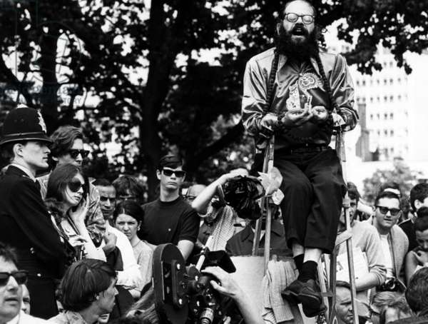Beat Poet Allen Ginsberg singing an Indian chant in Hyde Park London England. June 1966