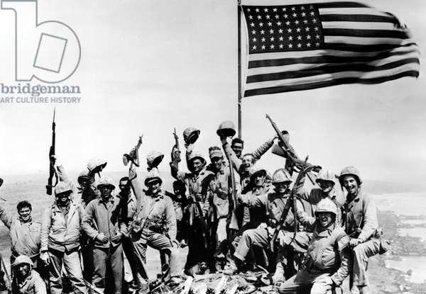 WORLD WAR II, Marines of the 28th regiment cheer after raising flag on Mt. Suribachi, Iwo Jima, 1945