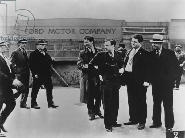 Battle of the Overpass at Ford River Rouge plant. Ford thugs vs. UAW. May 1937. United Auto Workers leader, Walter Reuther (5th from left), intending to hand out pamphlets is approached by Ford 'Service Department' thugs. Reuther is flanked by Robert Kanter and Richard Frankenstein. Photo by James Kilpatrick of the Detroit News