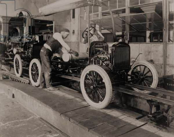 Ford Model Ts on the moving assembly line, first used by the Ford Motor Company in 1913