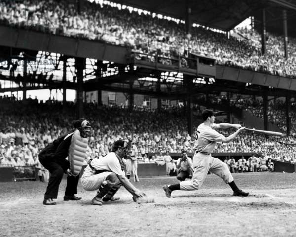 Joe DiMaggio breaks the record for hitting safely in consecutive games. This hit brought his streak to 42 games, June 1941