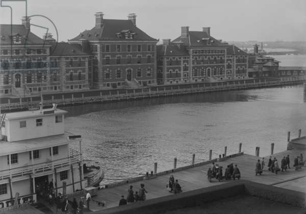 Well dressed immigrants arriving via Ferry at New York's Ellis Island. Ferries transported passengers from their Ocean going ship to the immigrant inspection station. c. 1910