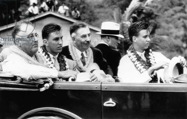 President Franklin D. Roosevelt (left), his son, Franklin Delano Roosevelt Jr. (second from left), Governor of Hawaii Joseph B. Poindexter (center), Roosevelt's son John Aspinwall Roosevelt (right), July, 1934