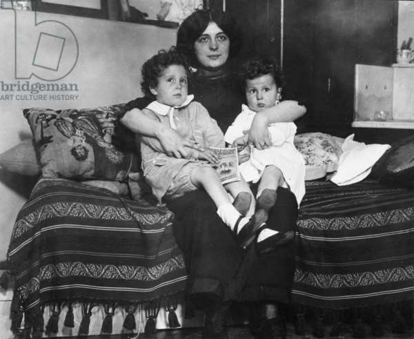 Survivors of the sinking of the Titanic, Louis and Michel Navratil, of Nice, France, on their mother's lap, 1912