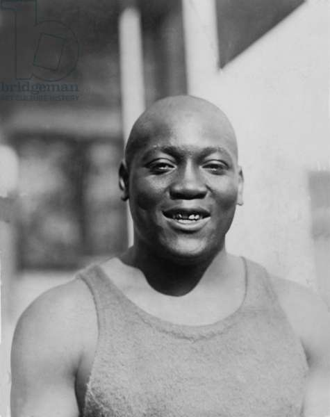 Jack Johnson (1878-1946) was the first African American to win the Heavyweight Championship in 1908. 1910 photo