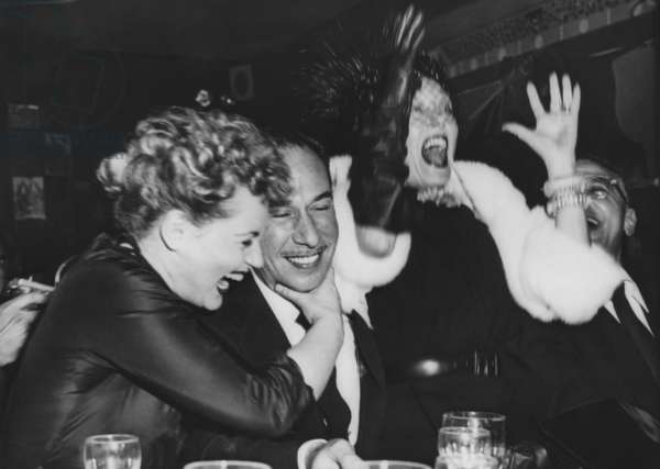 Judy Holiday (left) hugs Jose Ferrer after they heard that Ferrer and Holiday both won Oscars. March 29, 1951. They were in a New York City nightclub with Gloria Swanson (left). Holiday won for BORN YESTERDAY, and Ferrer for CYRANO DE BERGFERAC