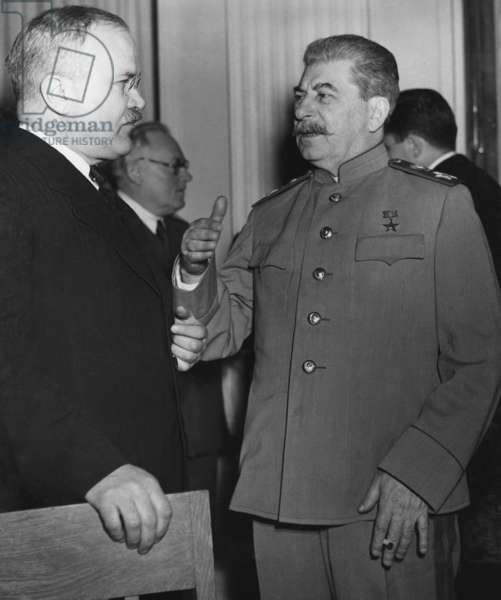 Joseph Stalin talks with his Foreign Minister Molotov at the Yalta Conference, Crimea. February 4–11, 1945. World War 2