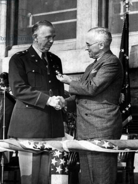 President Harry Truman (right), awarding a Distinguished Service Medal to General George C. Marshall in the Pentagon Courtyard, Washington D.C., November 26, 1945.