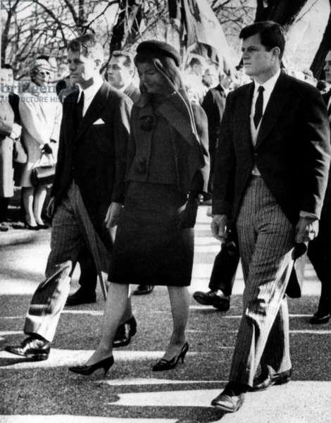 Attorney General Robert Kennedy, Jacqueline Kennedy and Senator Edward Kennedy walk behind President John F. Kennedy's casket, 1963