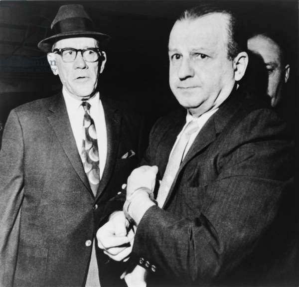 Handcuffed Jack Ruby, killer of JFK assassin Lee Harvey Oswald, escorted by Dallas County Sheriff Bill Decker, to a sanity evaluation, Dallas, Texas. 1963