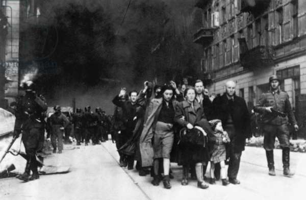 Jewish civilians 'forcibly pulled out of dug-outs' by Germans during the Warsaw Ghetto Uprising, April 19-May 16, 1943. Photo from the World War 2 report of SS officer Jürgen Stroop to Heinrich Himmler