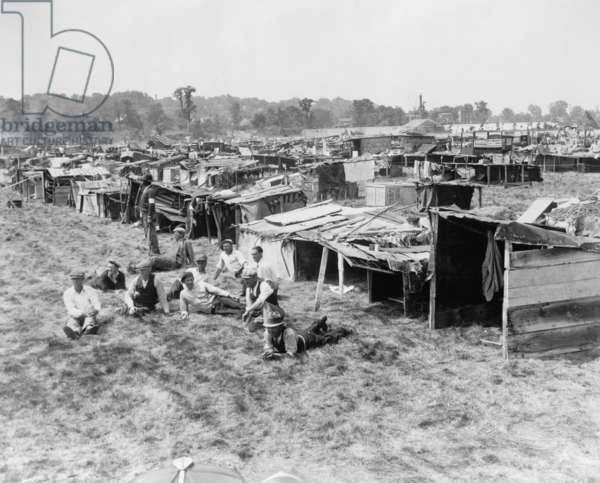 The Bonus Army built a Hooverville on Anacostia Flats, Washington, D.C. It would later be burned down by U.S. Army troops as they suppressed the veterans protest. June 11, 1932