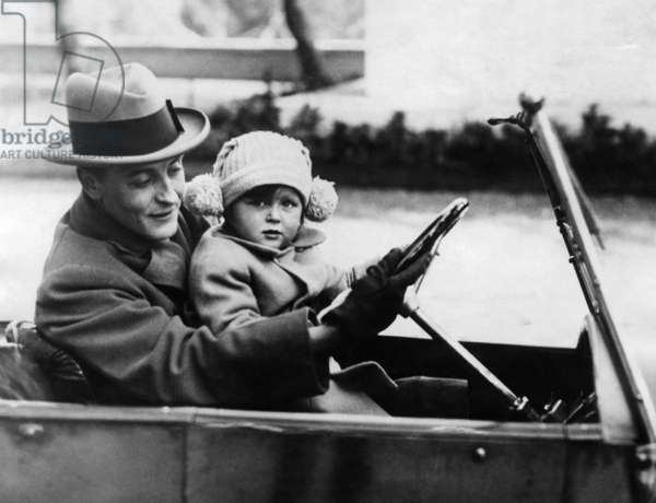 F. Scott Fitzgerald shows his daughter how to drive in Rome. 1924-1931.