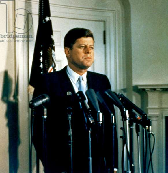 President John F. Kennedy standing at the microphone podium, early 1960s
