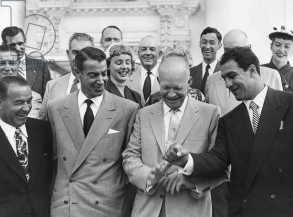 President Eisenhower with baseball great Joe DiMaggio, and boxing champion, Rocky Marciano. June 6, 1953. They were among 45 sports champions invited to attend the Congressional Baseball Game.