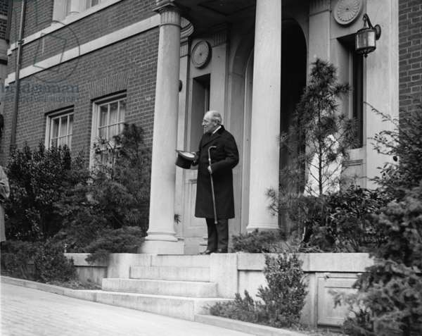 Ex-President Woodrow Wilson (1856-1924) standing on the porch of his Washington DC home on April 28, 1922