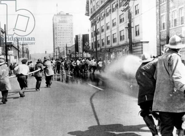 Firemen use hoses to disperse a civil rights demonstration in Birmingham, 1963