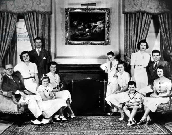 The Kennedy Family (clockwise on left) John F. Kennedy, Eunice, Jean, Patricia, Joseph P. Kennedy; (on the right, clockwise) Rosemary (standing), Joseph Jr., Rose Kennedy, Edward Kennedy, Kathleen, Robert (leaning on fireplace), December 10, 1937