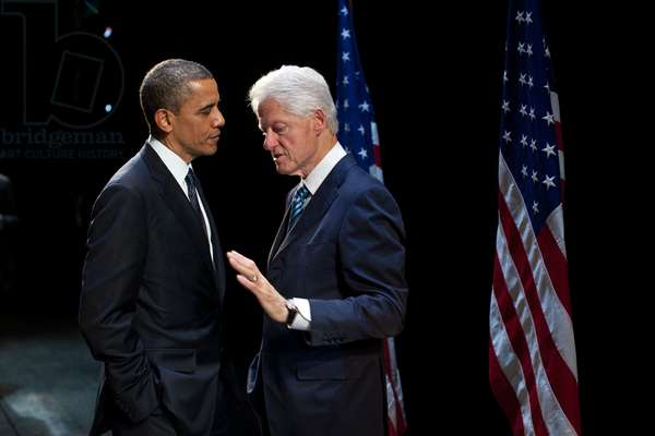 President Barack Obama with former President Bill Clinton at an election year fundraiser. Clinton introduced Obama at the New Amsterdam Theater in New York, June 4, 2012
