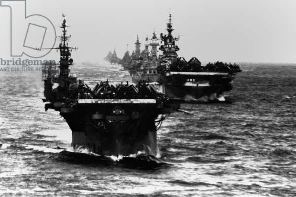 Task Group 38.3 entering Ulithi anchorage after the Philippine invasion and Battle of Leyte Gulf. Ship in line are: USS Langley, Ticonderoga, Washington, North Carolina, South Dakota, Santa Fe, Biloxi, Mobile, and Oakland. Pacific Ocean, World War 2