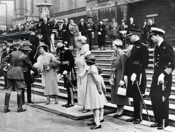 Queen Elizabeth (front, second from left), the former Duchess of York, King George VI (front, third from left), Princess Elizabeth (front, right of center), Princess Margaret (behind Princess Elizabeth), at their Coronation, England, May 12, 1937