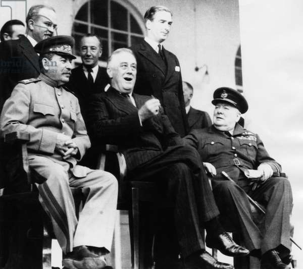 President Franklin D. Roosevelt (front center), meets with Soviet Union Premier Joseph Stalin (left), British Foreign Secretary Anthony Eden (top right), Prime Minister Winston Churchill (right), Teheran, Iran, 1943