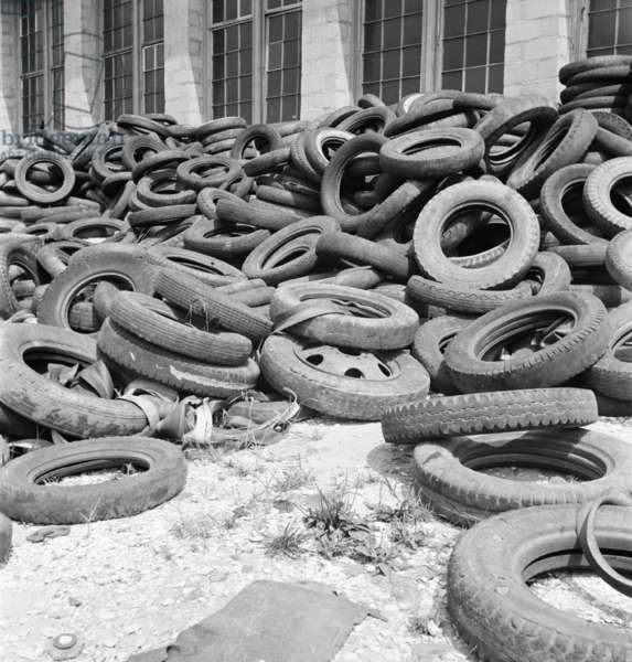 Rubber tires gathered to be recycled in August, 1941. Natural rubber was always expensive, and more so after World War II cut of supplies from Southeast Asia, making rubber conservation and recycling was essential