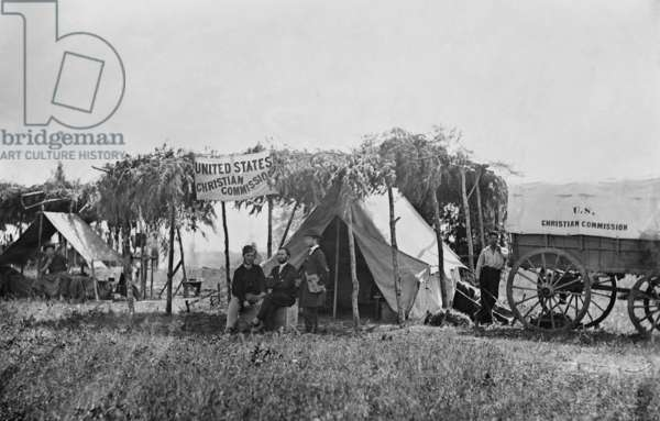 US Civil War, August-November 1863. Headquarters of the YMCA's US Christian Commission, with the Army of the Potomac, Germantown, Virginia. The USCC furnished supplies, medical services, and religious literature to regimental chaplains and Union troops during the American Civil War. It combined religious support with social services and recreational activities. Photo by Alexander Gardner