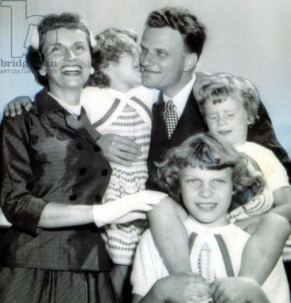 Billy Graham greeted by wife, Ruth & daughters Virginia,8, Anne,6, and Ruth, 3. 7/6/54.