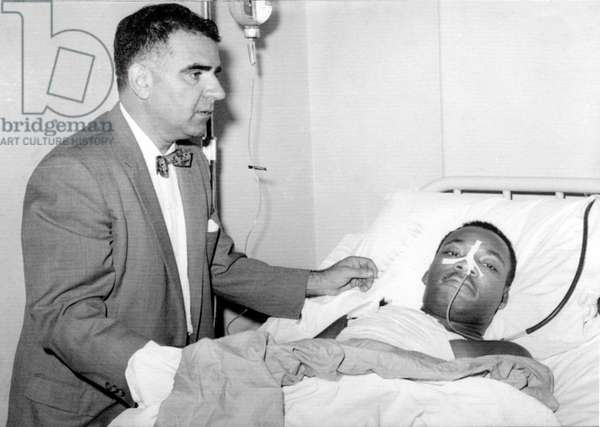 Martin Luther King Jr. in Harlem Hospital after stabbing in chest by letter opener, attended by Dr. Emil Naclerio, 9/22/58