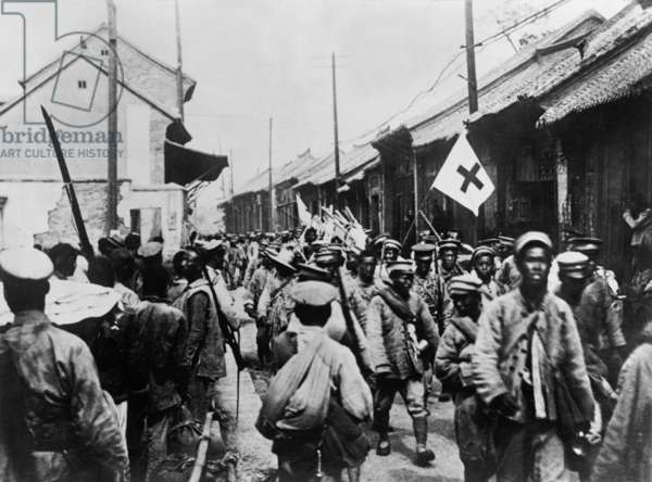 Retreating Chinese Nationalist soldiers entering the city of Tai-an. The Second Sino-Japanese War began in 1937 and merged into World War 2 when the Japanese attacked Pearl Harbor. c. 1938