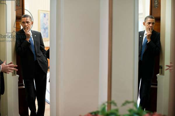 President Obama is reflected in a mirror as he talks with Bill Daley left and VP Joe Biden in the doorway of the Oval Office. April 8 2011. (BSWH_2011_8_127)