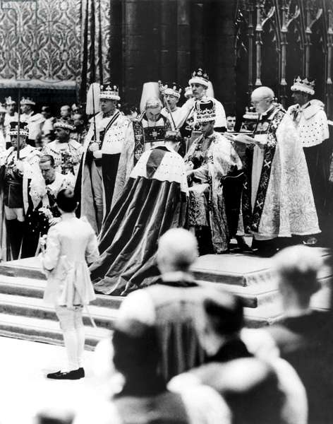 Peers, present in Westminster Abbey, London, May 12, on the occasion of the coronation of Queen Elizabeth I, who pays homage to King George VI, shown seated on his throne. 5/18/1937.