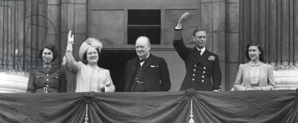 British Royal Family waves to crowds on Victory in Europe Day, May 8, 1945. Prime Minister Winston Churchill takes the central position of honor on the Buckingham Palace balcony. L to R: Princess Elizabeth, wear her ATS Uniform; Queen Elizabeth, Winston Churchill, King George and Princess Margaret.