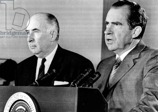 Attorney General John Mitchell and President Richard Nixon at a press conference during which Nixon declared Charles Manson guilty while Manson was still on trial. June 3, 1970.